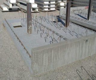 Elementi faccia a vista a completamento di una struttura di contenimento - stoccaggio in stabilimento